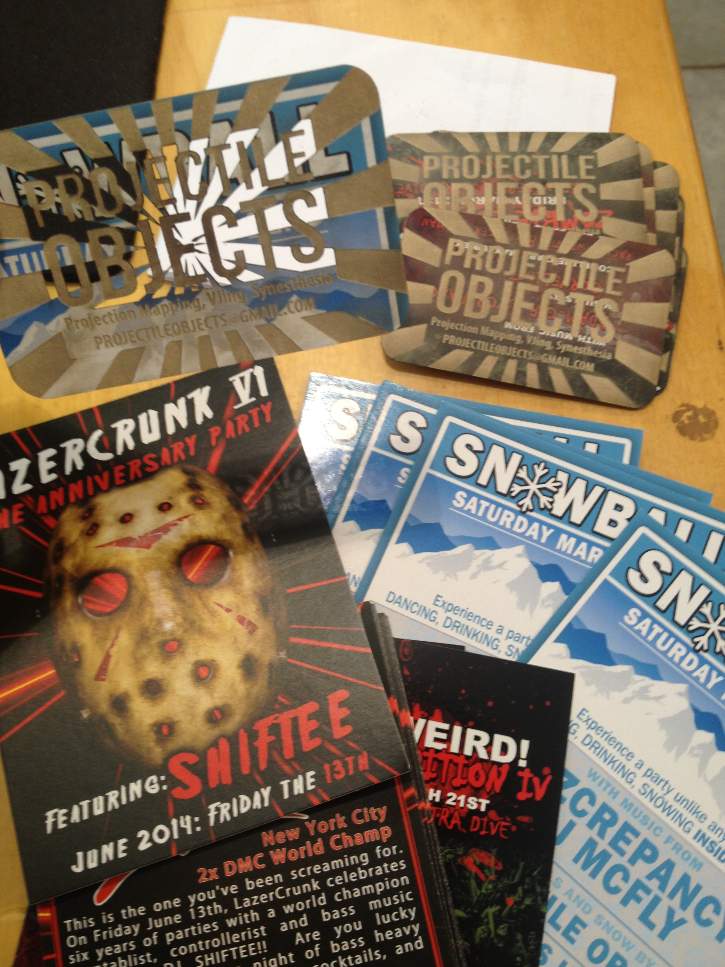 repurposing old party flyers as business cards – projectile objects